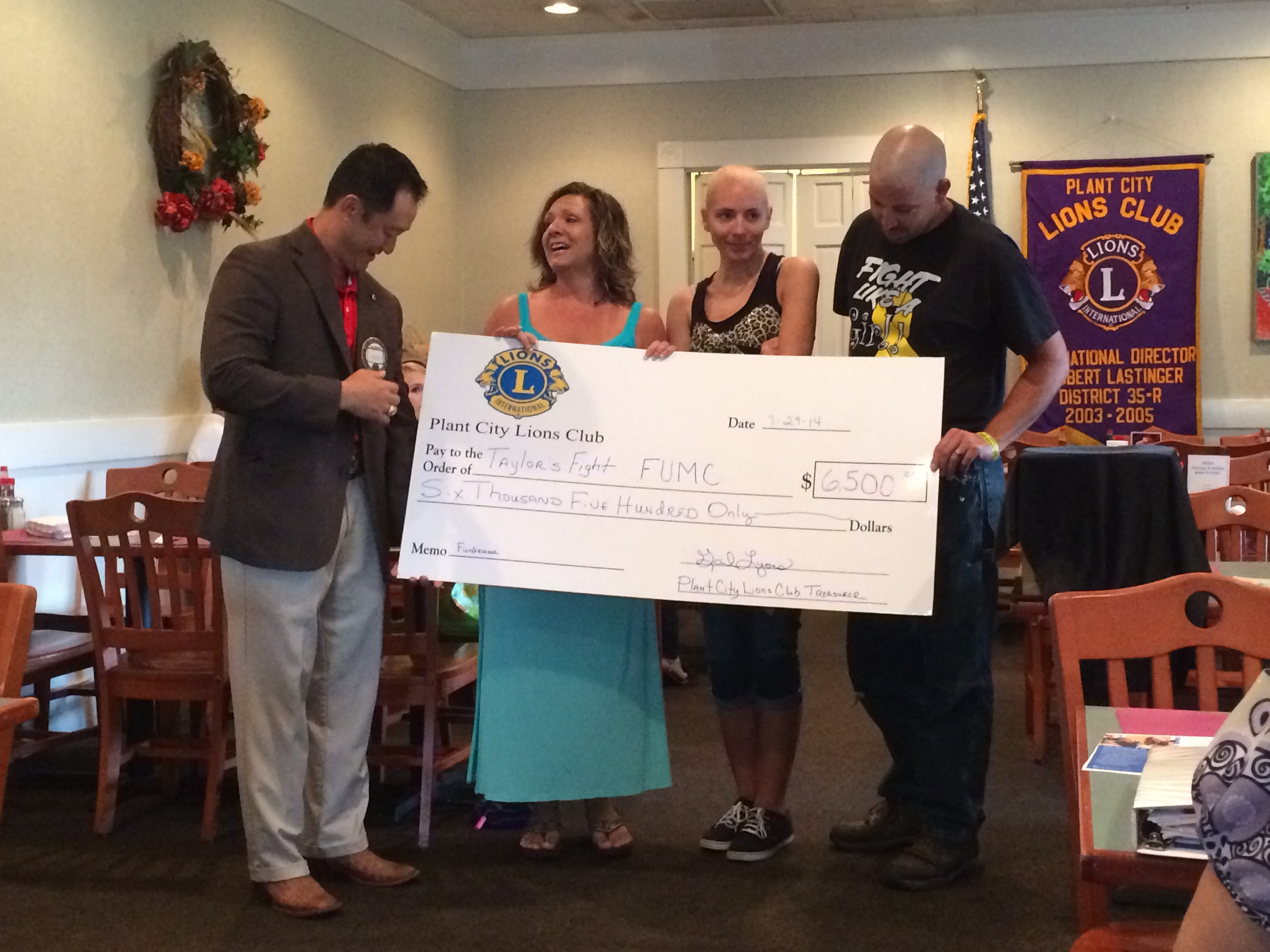 Plant City Lions Club Presents Taylor & Her Parents w/ A Check Of Funds Raised At The Taylor Fundraiser